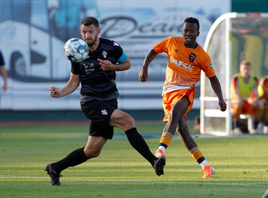 Lansing Ignite's Tumi Moshobane, right, scores on a shot against FC Tucson's Kyle Venter in the second half, Saturday, July 13, 2019, at Cooley Law School Stadium in Lansing, Mich. The teams played to a 2-2 draw.