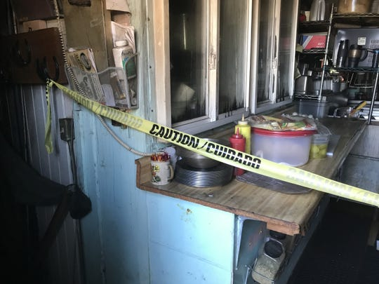 Caution tape blocks off basement stairs from the kitchen inside the Mason Depot Diner July 11, 2019. The former railroad depot, built in 1902, was heavily damaged by a fire earlier this month.