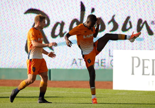 Lansing Ignite's Tumi Moshobane, right, and Rafa Mentzingen celebrate Moshobane's goal against FC Tucson, Saturday, July 13, 2019, at Cooley Law School Stadium in Lansing, Mich. The teams played to a 2-2 draw.