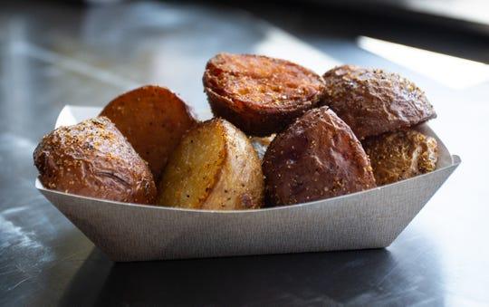 Bangos Food Truck's signature fried potatoes, outside Brew Cafe at 610 N. Creyts Road, Lansing, Michigan, Saturday July 13, 2019