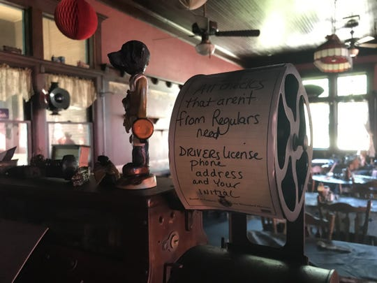 "A sign on the Mason Depot Diner's antique cash register reads ""All checks that aren't from regulars need driver's license, phone, address and your initial. Owner Rod Hunt said most of the customers at the breakfast and lunch spot are like ""family."" The diner was heavily damaged by fire earlier this month."