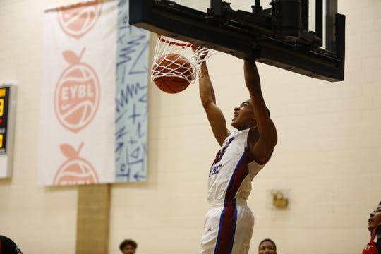 Team WhyNot's Nimari Burnett dunks the ball during Nike's Peach Jam.