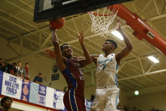 Isaiah Todd, right, defends during Nike's Peach Jam.