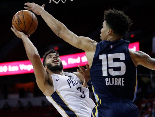 New Orleans Pelicans' Kenrich Williams, left, shoots around Memphis Grizzlies' Brandon Clarke, right, during the first half of an NBA summer league basketball game Sunday, July 14, 2019, in Las Vegas.