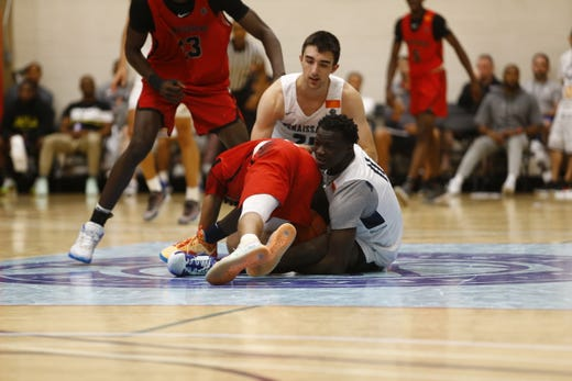 Players battle for a loose ball during Nike's Peach Jam in July 2019 in North Augusta, S.C.