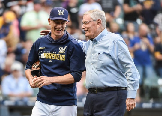 Brewers manager Craig Counsell greets former baseball commissioner Bud Selig after Selig threw out the ceremonial first pitch before a Brewers game against the San Francisco Giants earlier this season. Counsell grew up in a local suburb. Can you name it?
