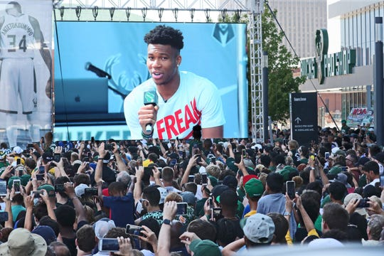 Hundreds of cellphone cameras were pointed at the stage and video screens as the Milwaukee Bucks' Giannis Antetokounmpo spoke.