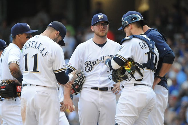 Brewers relief pitcher Corbin Burnes did not record an out in the seventh inning, giving up four runs on four hits.