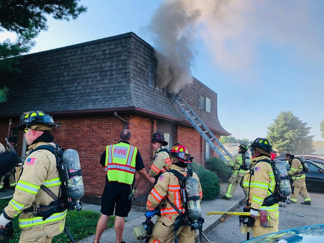 Newark Fire personnel battle a fire Saturday evening at an apartment building on Moull Street.