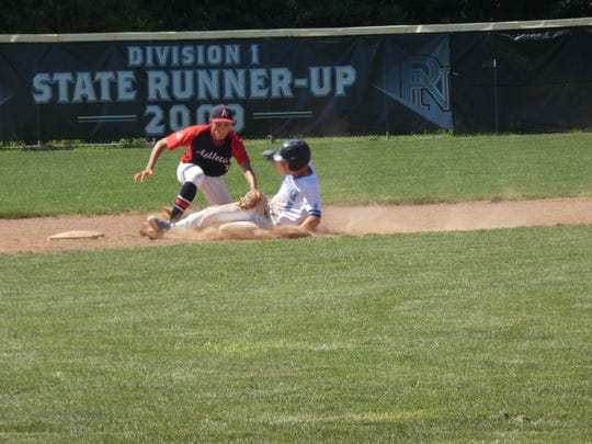 16U Athletics second baseman Ryan Davis tags out an Ohio Thunder base runner after catcher Wes Myers catches him stealing during Saturday's 8-6 victory for the A's at Pickerington North. The win advanced the A's to the semifinals of the season-ending Buckeye Elite.