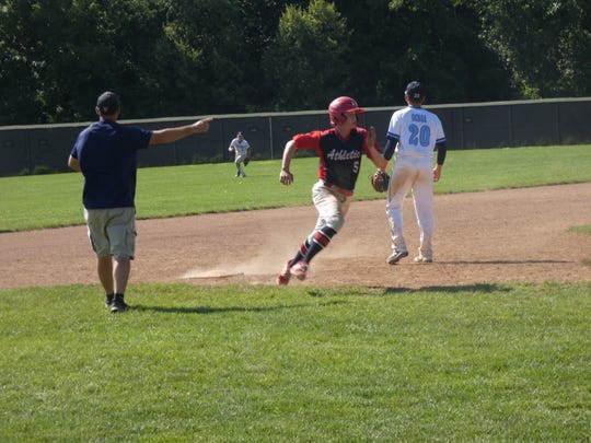 Chase Bebout rounds third and heads home to score the tying run Saturday for the 16U Athletics during an 8-6 victory against the Ohio Thunder at Pickerington North. The win advanced the A's to the semifinals of the season-ending Buckeye Elite.