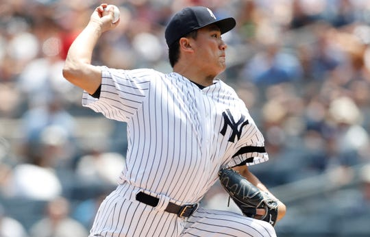 New York Yankees starting pitcher Masahiro Tanaka winds up during the first inning of a baseball game against the Toronto Blue Jays, Sunday, July 14, 2019, in New York. (AP Photo/Kathy Willens)