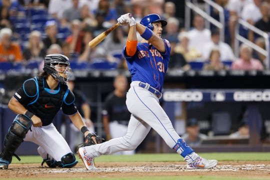Michael Conforto #30 of the New York Mets hits a two-run home run in the third inning against the Miami Marlins at Marlins Park on July 13, 2019 in Miami, Florida.
