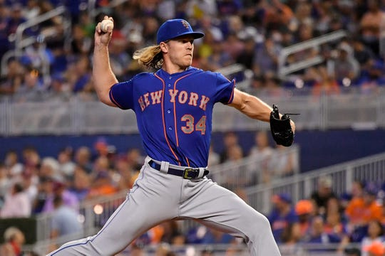 Jul 13, 2019; Miami, FL, USA; New York Mets starting pitcher Noah Syndergaard (34) delivers a pitch in the second inning against the Miami Marlins at Marlins Park.