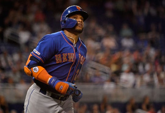 Jul 13, 2019; Miami, FL, USA; New York Mets second baseman Robinson Cano (24) rounds the bases after hitting a two run home run in the eighth inning against the Miami Marlins at Marlins Park.