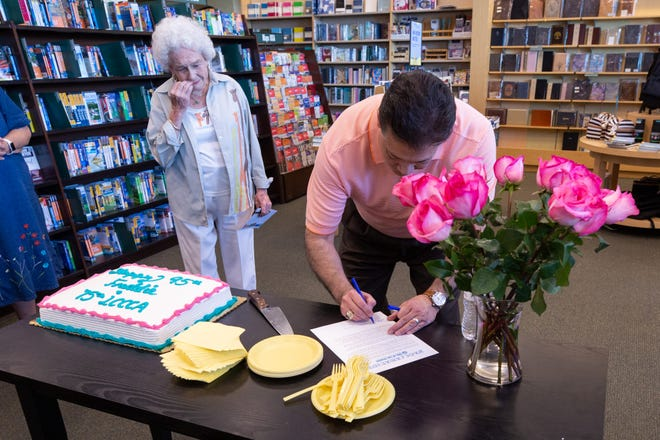 Mayor Ken Miyagishima signs a  proclamation honoring Freddie Olhausen-Finkner on Saturday, July 13, 2019 at the Mesilla Valley Mall Barnes and Noble. The Las Cruces Civic Concert Association was celebrating its 75th anniversary along with longtime board member Olhausen-Finkner, who turned 95 years old.