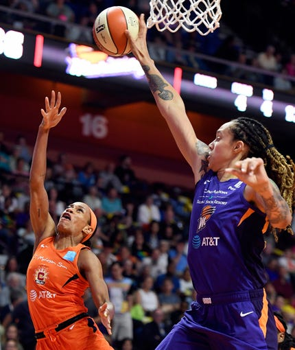 Phoenix Mercury center Brittney Griner, right, block the shot of Connecticut Sun guard Jasmine Thomas during the first half of WNBA basketball game Friday, July 12, 2019, in Uncasville, Conn.