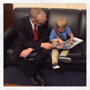 Grant Leonard shares his scrapbook with Rep. Andy Biggs in Washington, D.C.
