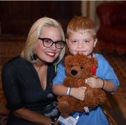 Grant Leonard poses with Sen. Kyrsten Sinema, who gave him a shout-out during the Senate hearing in Washington D.C.