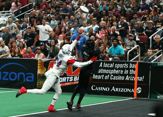 Arizona Rattlers wide receiver Anthony Amos (5) makes a touchdown catch past Sioux Falls Storm defensive back Daniel Lindsey (24) in the first half during the United Bowl on July 13, 2019 at Gila River Arena in Glendale, Ariz.