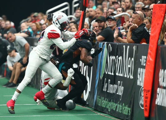 Arizona Rattlers wide receiver Jamal Miles (2) is tackled by the Sioux Falls Storm in the first half during the United Bowl on July 13, 2019 at Gila River Arena in Glendale, Ariz.