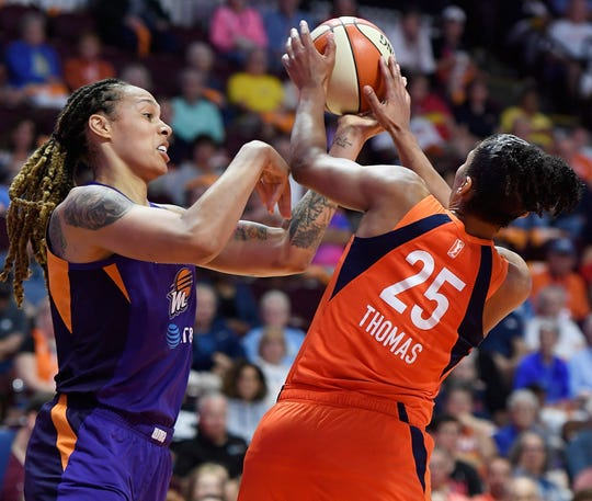 Connecticut Sun forward Alyssa Thomas works against Phoenix Mercury center Brittney Griner for a rebound during a WNBA basketball game Friday, July 12, 2019, in Uncasville, Conn.