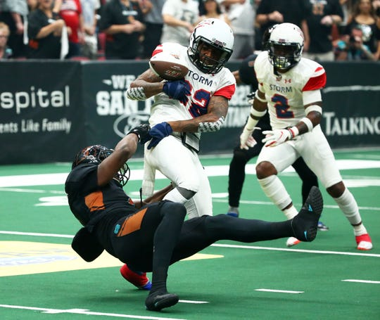 Sioux Falls Storm wide receiver Damond Powell Jr. (22) fumbles the ball with pressure from Arizona Rattlers defensive back Davontae Merriweather (8) in the first half during the United Bowl on July 13, 2019 at Gila River Arena in Glendale, Ariz.