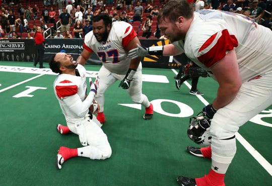 Sioux Falls Storm quarterback Lorenzo Brown Jr. (left) reacts after defeating the Arizona Rattlers ito win the United Bowl on July 13, 2019 at Gila River Arena in Glendale, Ariz.