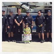 Grant Leonard poses with Gilbert Fire Department officers.