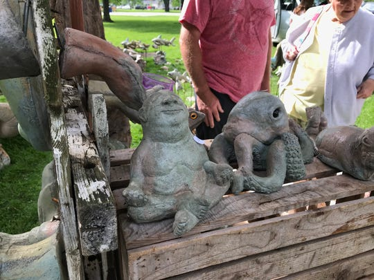 Jay Risner, a full-time sculptor, has a whole series of clay sculptures with the large, meditating, naked man character, among other concrete garden art he creates.