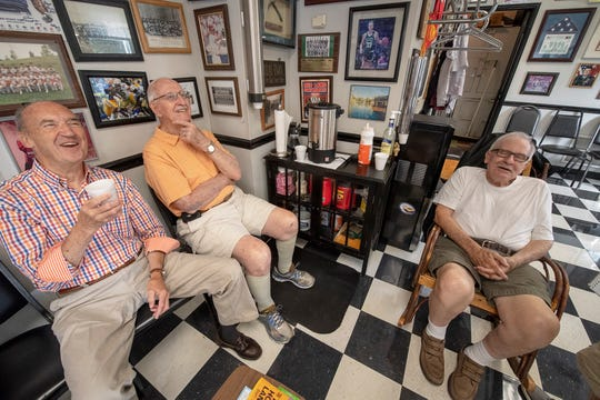 Jack Baumbach, 97, center, shares a laugh with friends Ken Smeltzer, 82, left, and Jack Murray, 85, right, at Semoff's Barber Shop in New Cumberland. Baumbach is a WWII vet and Marine who served at Iwo Jima.