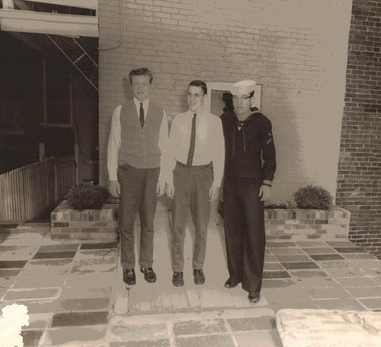Brothers (left to right) Henry Schaad, Barry Schaad, and Russell Schaad pose for a photo.