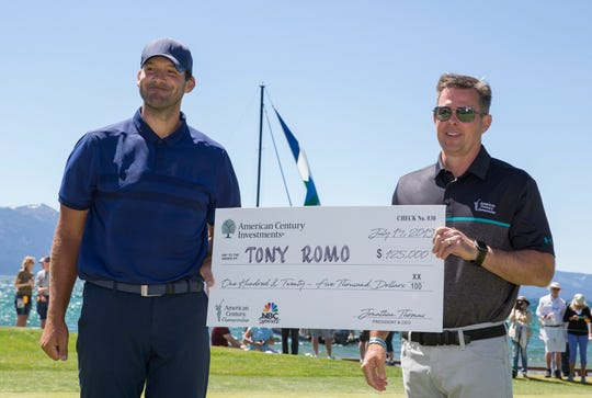 Tony Romo, left with the check he will donate to charity during the ACC Golf Tournament at Edgewood Tahoe Golf Course in South Lake Tahoe on Sunday, July 14, 2019.