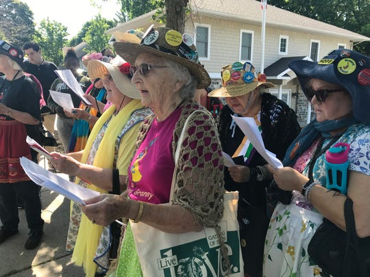 Members of the Rochester Raging Grannies sing at a protest on Pattonwood Drive in Irondequoit on July 14, 2019.