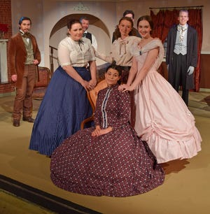 """Samatha Bautista (seated) as Marmee, is flanked by Lauren Stanfield (Meg), left, Shay Little (Jo) and Sarah Redmill (Amy) in a scene from Riverfront Playhouse's """"Little Women."""" The play opens Saturday. Pictured in the back are Samuel Story, left, Rob Hanson, Ian Dalziel and Isaiah Isome."""