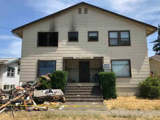 Several units in the Carol Apartments complex will be uninhabitable over the next several days following a two-alarm fire that began on the second floor early Sunday, July 14, 2019. Burnt tables, seat cushions, a couch and other household items lay in a pile outside the building.