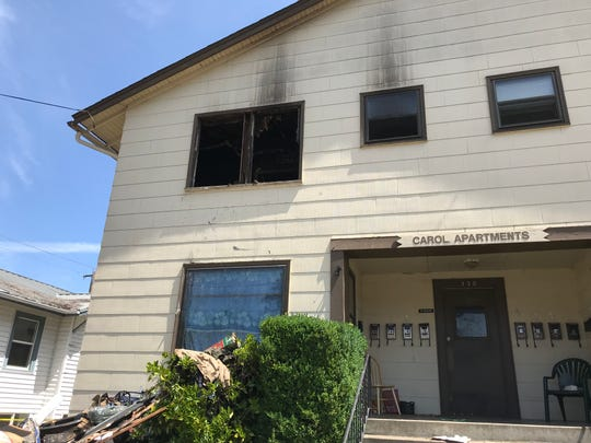 Firefighters rescued a woman through a window using a ladder after she became trapped in her apartment during a two-alarm fire in southeast Salem on early Sunday, July 14, 2019.