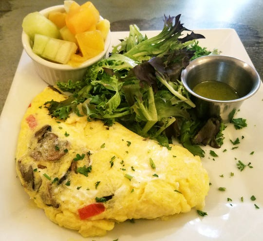 The mushroom omelette was buttery and filled with a medley of mushrooms Brie, and tomatoes.