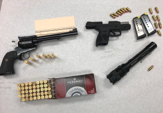 Handguns and ammunition found by Oxnard police during a parole search on Saturday.