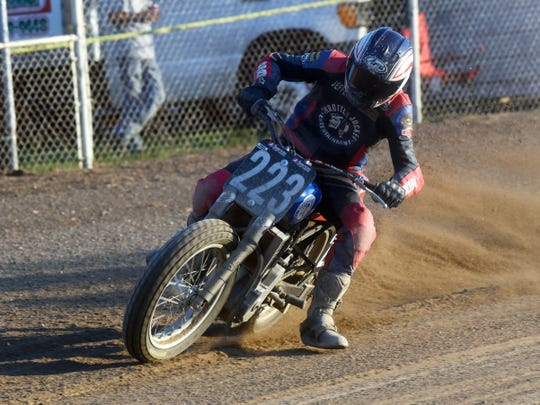 Jeffery Lowery, of Newark, drives his 450 during the AMA Flat Track All-Star Series races on Saturday at the Muskingum County Fairgrounds. Sixty drivers from eight states participated.