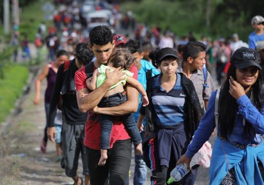 Honduran migrants move north after crossing the border into Guatemala on October 15, 2018.