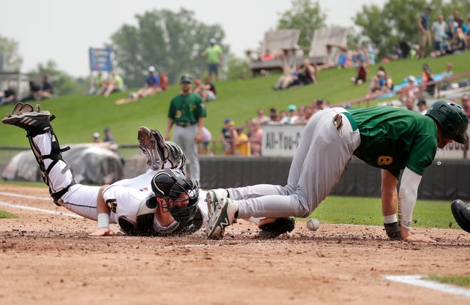 The Beloit Snappers' Max Schuemann gets past the Timber Rattlers' David Fry for a run Monday, July 8, 2019, at Neuroscience Group Field at Fox Cities Stadium in Grand Chute, Wis. The Rattlers lost 11-2.
