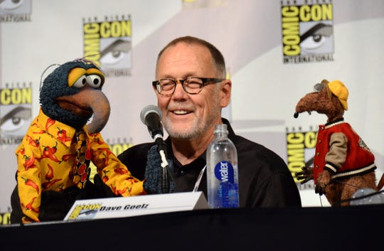 "In this July 11, 2015 file photo, puppeteer Dave Goelz, center, appears with Muppet characters Gonzo, left, and Rizzo the Rat attend ""The Muppets"" panel at Comic-Con International in San Diego."