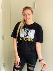 Marina Mabrey sports her new t-shirt