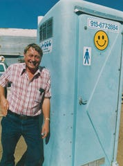 Lou Paulsen with a blue portable toilet in 1986.