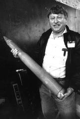 Lou Paulsen with a replica of an artillery shell for a 1987 auction to benefit Abilene Boys Ranch.