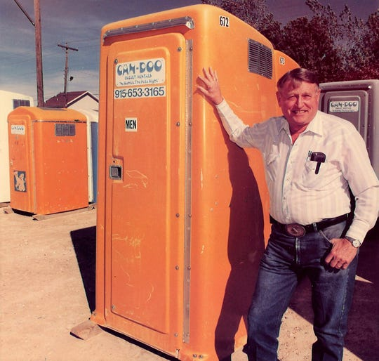 Lou Paulsen with an orange portable toilet in 1994.