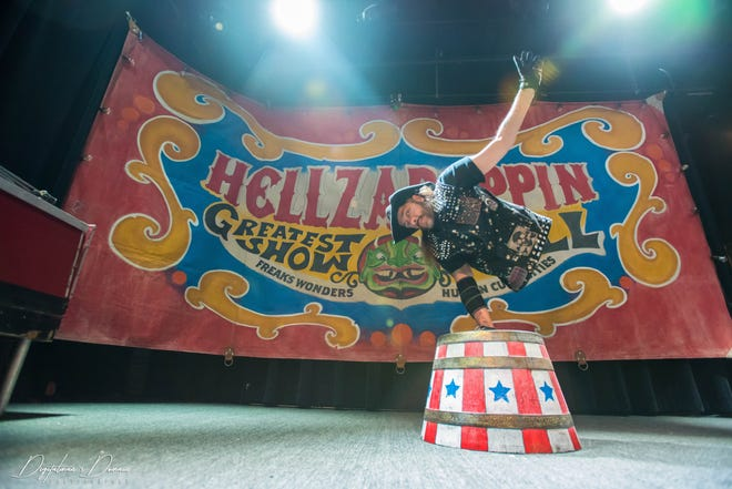 """Aaron """"Shorty"""" Wollin performs as part of the Hellzapoppin Circus Side Show Review."""