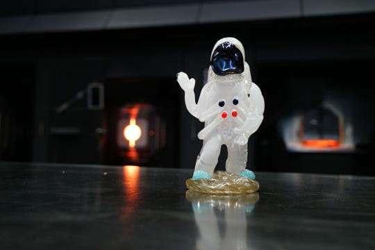 At Corning Museum of Glass, a glass astronaut figurine is discreetly placed in the 50th anniversary exhibit for guests to find during their visit.
