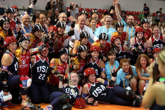 Team USA and Team Spain pose together after  their bout July, 10.